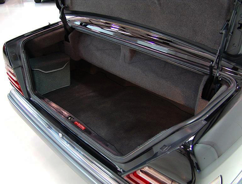 Trunk compartments were the same on all 124-body cabrios.  A tool kit and leather owner manual pouch came standard with the car.  (Photo credit: L. Plugg)