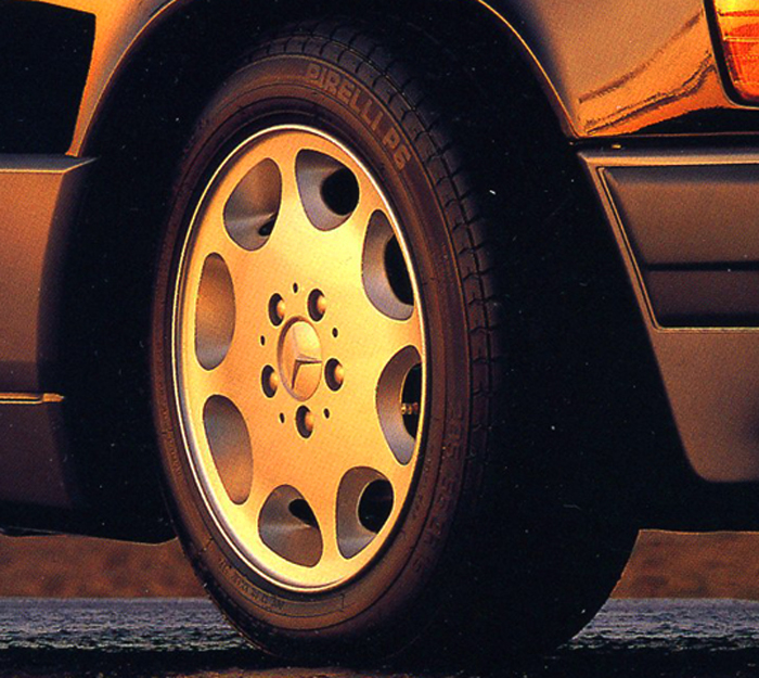 These eight-hole 15-inch aluminum wheels were standard on all 124 body cabriolets from 1993-on.  In keeping with decades of tradition, the aluminum wheels were painted silver as shown in this 1993 U.S. market brochure picture.  (Photo credit: Mercedes Benz USA)
