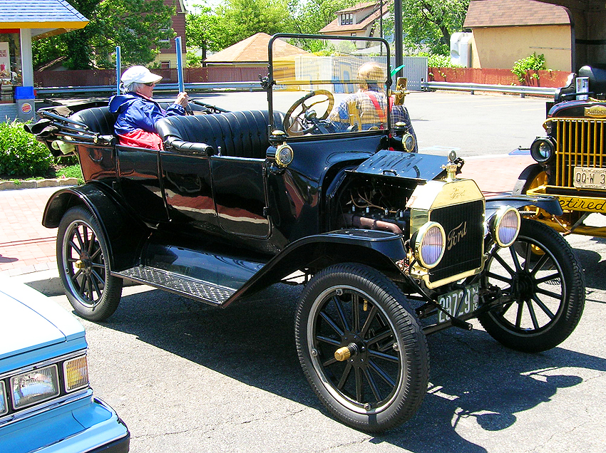 (20 model years)  1908 - 1927 FORD MODEL T.  The Model T of 1908 was the first automobile to be produced on an assembly line, and sold over 15 million copies during its two decade run.  Here a 1915 model is shown - Photo credit: Sean Connor