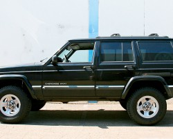 (18 model years)  1984 - 2001 JEEP CHEROKEE.  The Cherokee of 1984 introduced compact 4-door sport utilities to the American market.  Squared-off proportions and off-road ability made these popular with buyers, and styling was retained with few updates.  Here a 1996 model is shown - Photo credit: J. Costaldo