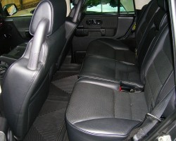 Second row seat view of a Discovery equipped with dark gray interior.  Unlike tan interior models, seat edging was not highlited.  2004 SE7 shown.  (Photo credit: Sean Connor)