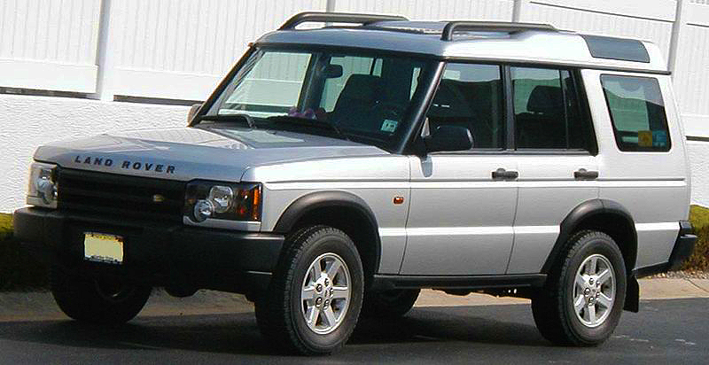 "2003 - 2004 Discovery ""S"" left front view.  Base models were now designated as ""S"".  As in prior years, front bumper covers were unpainted.  2004 model shown.  (Photo credit:"