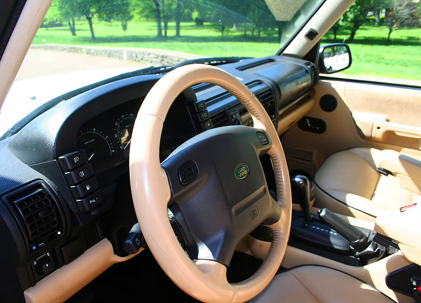 During all years, Discovery II buyers had a choice of tan or dark gray interiors.  Driver side airbag assemblies, dashboards and center consoles were black regardless.  2004 Discovery SE shown.   (Photo credit: H. Norris)