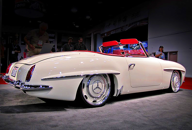 The new creation's height adjustable suspension system was customized by tuning firm RennTech.  The driver can select height settings from low-rider to original 1961 factory level.  (Photo credit: L. Singer)