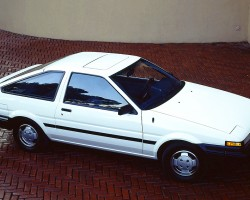This view of a 1986 SR5 hatchback shows the base level bumpers that were unpainted, and 13-inch standard steel wheels.  (Photo credit: Toyota Motor of North America Inc.)