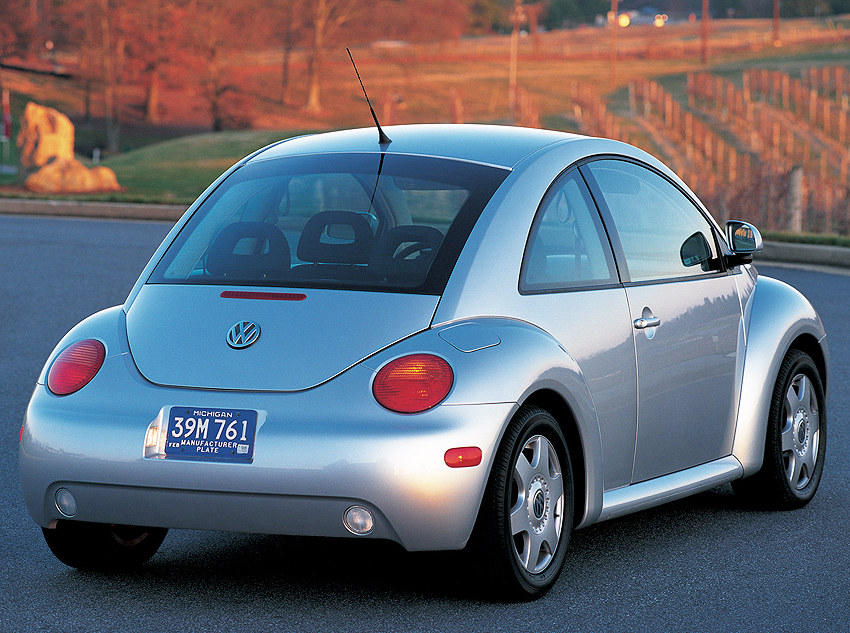 (13 model years)  1998 - 2010 VOLKSWAGEN NEW BEETLE.  VW created a modern, front-wheel-drive version of its economy car classic for 1998.  Popularity with buyers kept this design running with only a minor freshening for 2006.  Here a first-year 1998 New Beetle is shown - Photo credit: A. Moody
