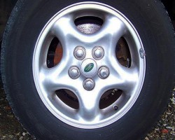 Stock 16-inch aluminum wheels of this design were standard on base models through 2002.  (Photo credit: N. Rennoc)