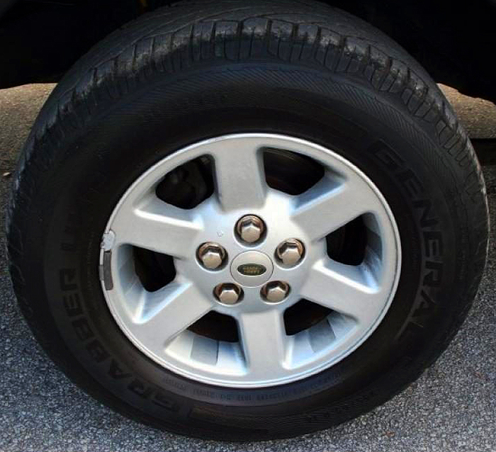 For 2003-04, base 16-inch aluminum wheels were redesigned to look like this (equipped on S models only).  Photo credit: F. Parker