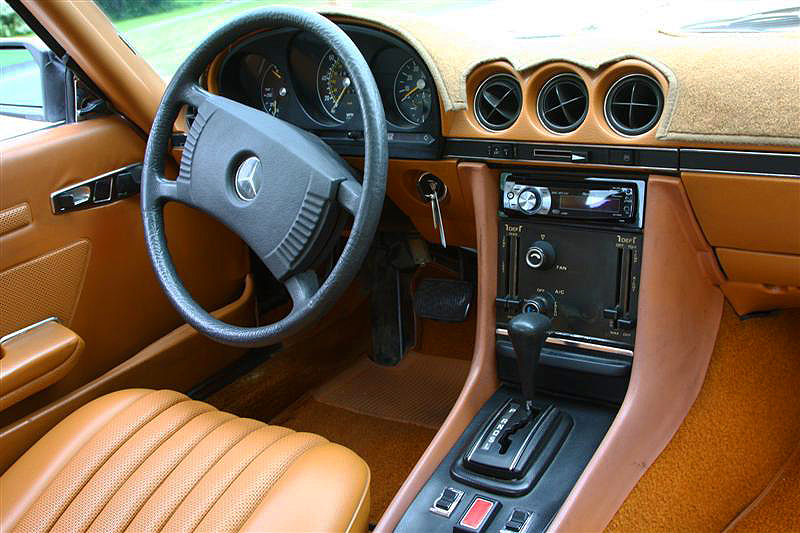 This SL interior shows the original steering wheel design that ran through 1979 and manual sliding levers for heat control that ran through 1977 on U.S. models.