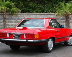1986 Mercedes 560SL.  As required by U.S. federal law, all 1986 and later vehicles featured third brake lights mounted up high in the center area.