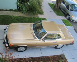 gold 1988 Mercedes 560SL