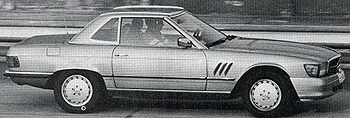 Spy photos such as this one circulated in mid-1980s car magazines prior to the 560SLs introduction showed 107s desert testing with one-piece, integrated plastic bumpers in place of the 1974 design units.  For whatever reasons, they never made production and the classic style bumpers were retained through 1989.