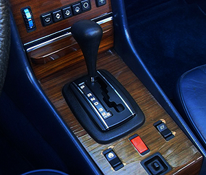 "For 1982, 380SLs got more modern climate control and window switches as seen in this photo. Notice also since this picture is of an '83 model, you can also see that year's new ""D-3-2"" gearshift gate."