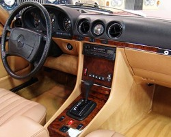 "Driver-side airbags were introduced as standard equipment late in the 1985 model year. Steering wheels equipped with airbags like this '85 can be spotted at quick glance, and feature a larger center piece with ""SRS"" (Supplemental Restraint System)"