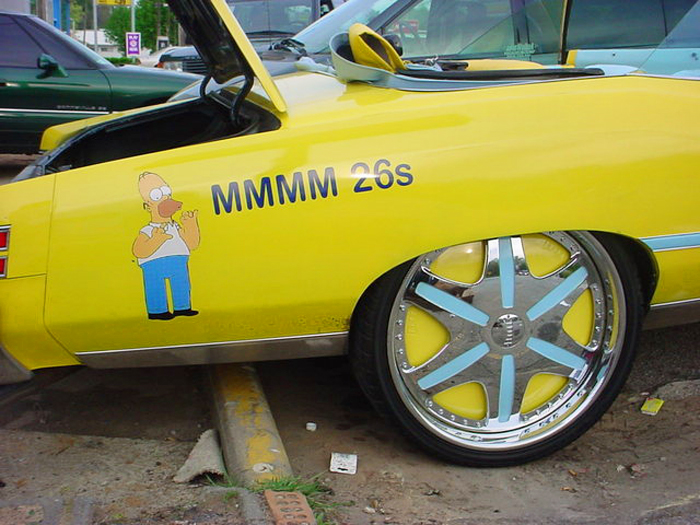 (Alternate DONK)  1975 Pontiac Grand Ville convertible.  As Homer Simpson points out, 26-inch rims are installed.