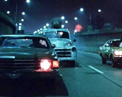 "By 1985 Sam's car had lost all its original hubcaps, as seen during this action scene in ""Crimewave""."