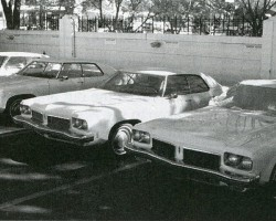 While Sam's 1973 Oldsmobile (center) was often beat up and damaged in early films, today the Delta 88 has stunt doubles for the hard knocks.