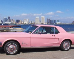 1968 pink Ford Mustang wire wheel covers