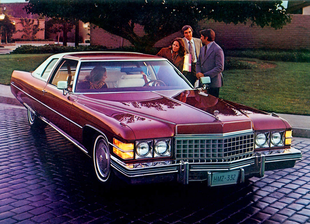 red 1974 Cadillac Coupe deVille