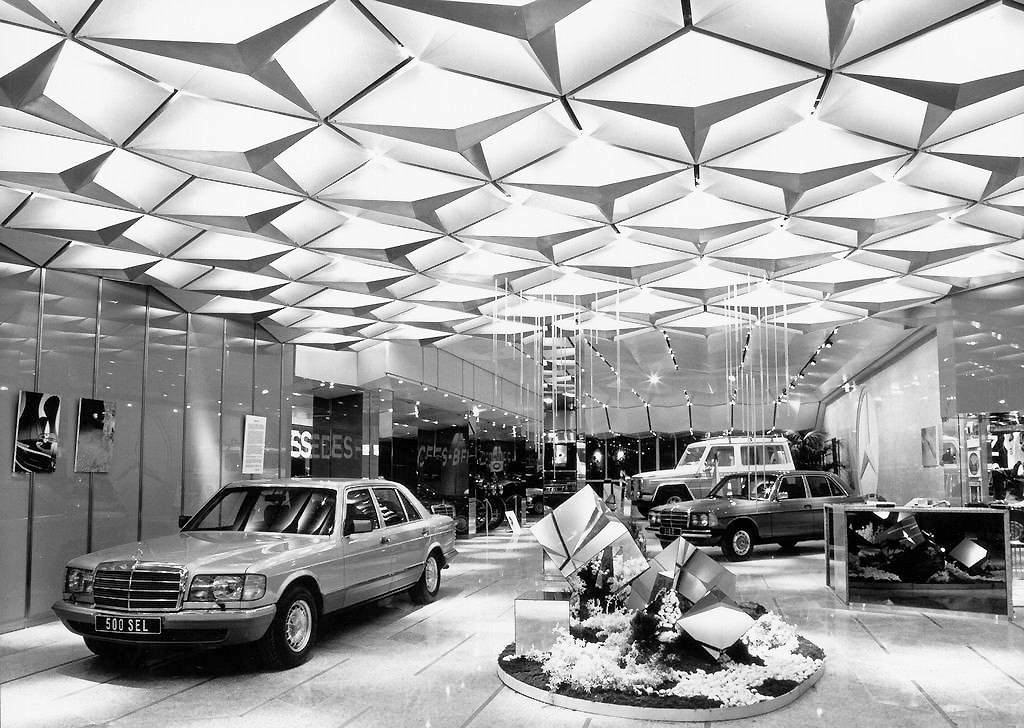 A 1981 Mercedes 500SEL, Galaendewagen, and 123-body sedan are visible in this picture taken in a Paris Mercedes showroom.