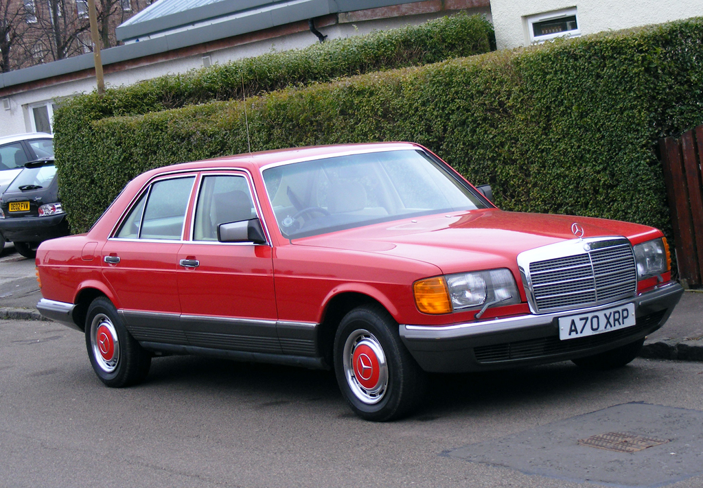 1984 mercedes 280se with color matched wheel covers for Mercedes benz hubcaps
