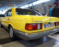 yellow Mercedes 560SEL 126