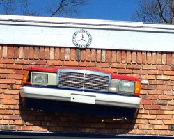 Mercedes 190E front on building