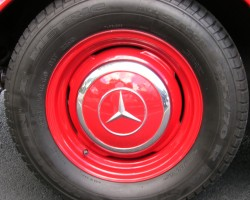red 1963 Mercedes color matched hub cap