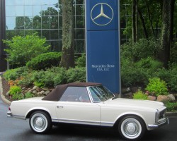 white 1964 mercedes 230sl