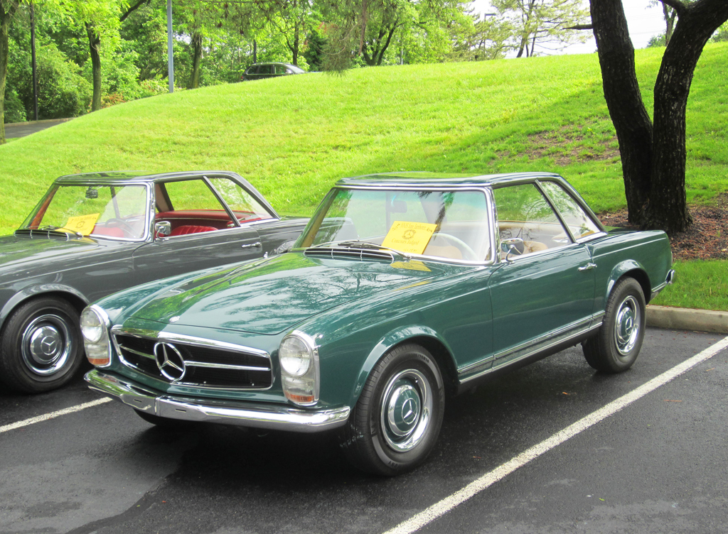 green 1966 mercedes 230sl