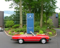 red 1988 Mercedes 107