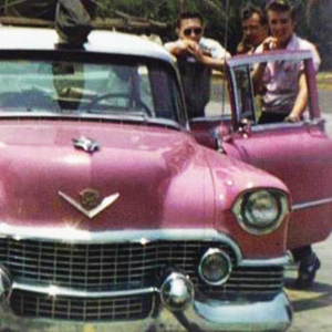 A rare picture of Elvis and band members with the original pink Cadillac he owned.  This 1954 Fleetwood was the first Cadillac he purchased, and it was lost due to vehicle fire soon after.  He later purchased a 1955 model that was custom painted to match this one.  The '55 is the one he held onto, and the one everyone remembers him by.
