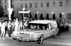 In this picture on August 16, 1977 a 1976 Cadillac hearse owned by a Memphis funeral home transports Elvis's body from Baptist Hospital in Memphis after his autopsy was performed.