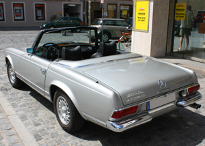 small 1970 Mercedes 280SL with bundt rims