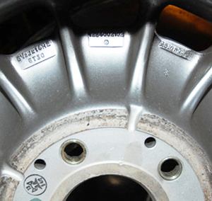 One fail-safe way to tell any original Fuchs-made factory wheels from aftermarket ones is the locations of the serial numbers.  Fuchs wheels have them on the inside, and aftermarket wheels have them on the outside.