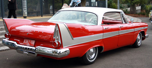 Rear view of a white-over-red 1958 Plymouth Fury hardtop sedan, similar to the one in the book.