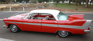 Side view of a white-over-red 1958 Plymouth Fury hardtop sedan, similar to the one in the book.