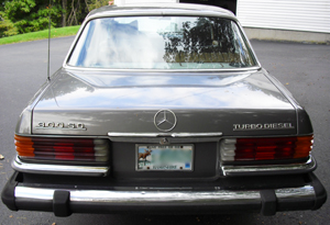 The rear view of a gray Mercedes 300SD Turbodiesel.