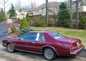 Here, the 1982 Chrysler Imperial featured in this article is seen in front of the house used as Tony Soprano's in the HBO series The Sopranos.  For early-'80s mob guys who were polarized around Lincoln or Cadillac styling, 1981-83 Imperials sought to give them a third choice which had elements of both.