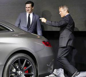 "The 2015 Mercedes-Benz S-class coupe AMG model is on display all week at the NY Auto Show.  Here, actor Jon Hamm of AMCs ""Mad Men"" introduces the S63 AMG coupe to the press along with Mercedes USA CEO."