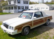 This photo allows a view of the front of a 1983 LeBaron Town & Country convertible.