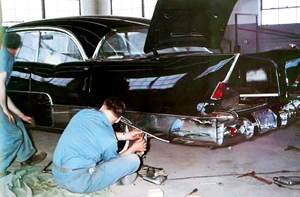 Here, rear quarter panel trim is applied to a 1957 El Morocco in Allender's 2-story workshop in Detroit.