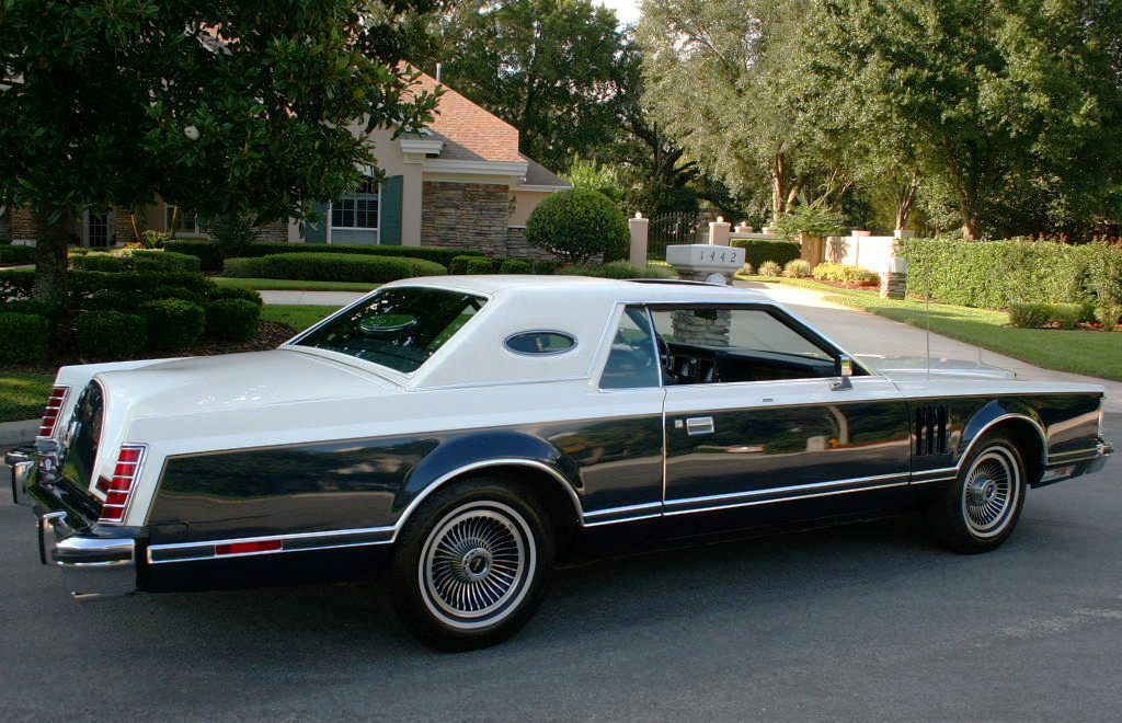 Parked in drive: 1979 lincoln continental mark v bill blass edition.