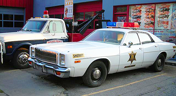 Sheriff Rosco P  Coltraine's police car and Cooter's truck
